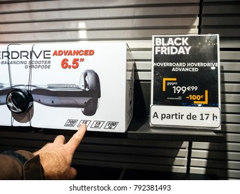 PARIS, FRANCE - NOV 23, 2017: Black Friday store shopping day in France, Paris with customers buying electronics gadget in Fnac retail chain Self Balancing Scooter Hoverdrive with 199 euro price