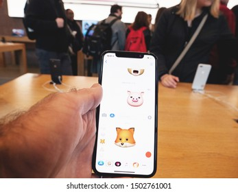 Paris, France - Nov 3, 2017: Customers admiring Animoji inside Apple Store the latest professional iPhone smartphone manufactured by Apple Computers