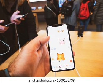 Paris, France - Nov 3, 2017: Customer admiring Animoji inside Apple Store the latest professional iPhone smartphone manufactured by Apple Computers