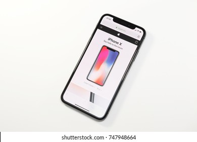 PARIS, FRANCE - NOV 3, 2017: New Apple iPhone X 10 smartphone with Apple Store website on the OLED Super Retina Display
