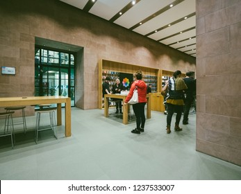 PARIS, FRANCE - NOV 8, 2018: Customers inside Apple Store with Apple genius employee helping them to buy and configure repair products