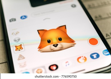 PARIS, FRANCE - NOV 9 2017: Fox animal 3d animoji emoji generated by Face ID facial recognition system with sad face emotion close-up of the new iphone X 10 Display - tilt-shift lens used
