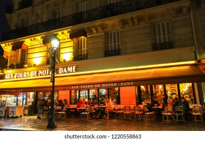 PARIS, France - November 01 , 2018: Aux tours de Notre Dame is traditional French cafe located in the Notre Dame neighborhood in Paris, France.
