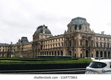 "Paris, France - November 04, 2017: Fragment of the building of the Louvre Museum in the ""Napoleon and Louvre Pyramid"" Courts of the Louvre Palace and The Place du Carrousel in autumn"