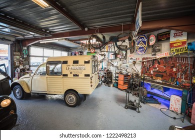 PARIS, FRANCE - NOVEMBER 05, 2018: An antique car garage workshop specialised in the iconic French oldtimer classic car Citroen 2CV