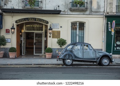 PARIS, FRANCE - NOVEMBER 05, 2018: A French oldtimer classic car icon Citroen 2CV parked in the characteristic Streets of the French capital Paris