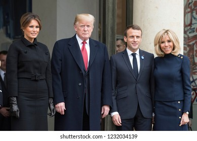 PARIS, FRANCE - NOVEMBER 10, 2018 : Emmanuel Macron and Brigitte Macron with the President of USA Donald Trump and his wife Melania Trump at the Elysee Palace for an extended interview.