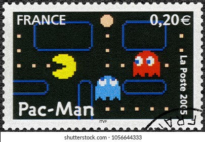 PARIS, FRANCE - NOVEMBER 11, 2005: A stamp printed in France shows Pac-Man, Games, 2005