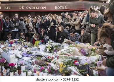 PARIS, FRANCE - NOVEMBER 14, 2015 :  People in front of the restaurant Le Petit Cambodge street Alliber in tribute to victims of the Nov. 13, 2015 in Paris at the Bataclan.