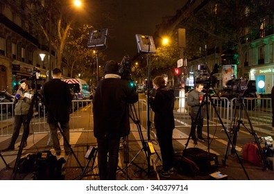 PARIS, FRANCE - NOVEMBER 14, 2015: Reporters working near the Republic Square in Paris after November 13 terror attacks in Paris.