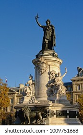 PARIS, FRANCE,  NOVEMBER 14, 2017, Monument to the republic, bronze statue of Marianne, a personification of the French republic, towering above tree tops, Paris, 14 November 2017