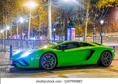 Paris, France - November 14, 2018: Bright green Lamborghini Aventador S Roadster on Av. Champs-Elysees at night