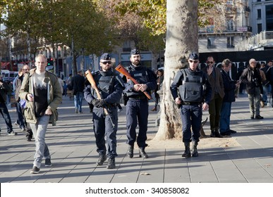 PARIS, FRANCE - NOVEMBER 15, 2015: People gathering together in memory of the victims of the November 13 terror attacks in Paris at Republic Square