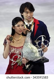 PARIS, FRANCE - NOVEMBER 16, 2013: Qing PANG / Jian TONG of China pose during the victory ceremony after winning gold medals at Trophee Bompard ISU Grand Prix at Palais Omnisports de Bercy.