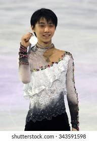 PARIS, FRANCE - NOVEMBER 16, 2013: Yuzuru HANYU of Japan poses during the victory ceremony at Trophee Bompard ISU Grand Prix at Palais Omnisports de Bercy.