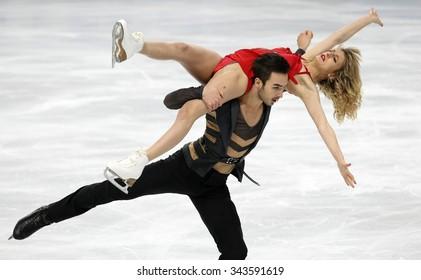PARIS, FRANCE - NOVEMBER 16, 2013: Gabriella PAPADAKIS / Guillaume CIZERON of France perform free dance at Trophee Bompard ISU Grand Prix at Palais Omnisports de Bercy.