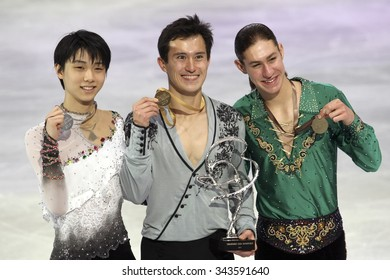 PARIS, FRANCE - NOVEMBER 16, 2013: Yuzuru HANYU (L), Patrick CHAN, Jason BROWN  pose during the victory ceremony at Trophee Bompard ISU Grand Prix at Palais Omnisports de Bercy.