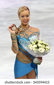 PARIS, FRANCE - NOVEMBER 16, 2013: Anna POGORILAYA of Russia poses during the victory ceremony at Trophee Bompard ISU Grand Prix at Palais Omnisports de Bercy.