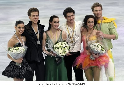 PARIS, FRANCE - NOVEMBER 16, 2013: ILINYKH/KATSALAPOV (L); VIRTUE/MOIR; PECHALAT/BOURZAT pose during the victory ceremony in ice dance at Trophee Bompard ISU Grand Prix at Palais Omnisports de Bercy.