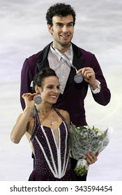 PARIS, FRANCE - NOVEMBER 16, 2013: Meagan DUHAMEL / Eric RADFORD of Canada pose after winning silver medals during the victory ceremony at Trophee Bompard ISU Grand Prix at Palais Omnisports de Bercy.