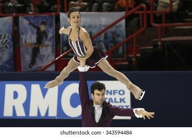 PARIS, FRANCE - NOVEMBER 16, 2013: Meagan DUHAMEL / Eric RADFORD of Canada perform free program at Trophee Bompard ISU Grand Prix at Palais Omnisports de Bercy.