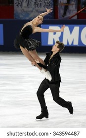 PARIS, FRANCE - NOVEMBER 16, 2013: Elena ILINYKH / Nikita KATSALAPOV of Russia perform free dance at Trophee Bompard ISU Grand Prix at Palais Omnisports de Bercy.