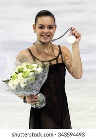 PARIS, FRANCE - NOVEMBER 16, 2013: Adelina SOTNIKOVA of Russia poses during the victory ceremony at Trophee Bompard ISU Grand Prix at Palais Omnisports de Bercy.