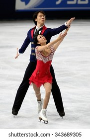 PARIS, FRANCE - NOVEMBER 16, 2013: Qing PANG / Jian TONG of China perform free program at Trophee Bompard ISU Grand Prix at Palais Omnisports de Bercy.