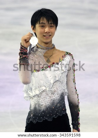 PARIS, FRANCE - NOVEMBER 16, 2013: Yuzuru HANYU of Japan poses during the victory ceremony at Trophee Bompard ISU Grand Prix at Palais Omnisports de Bercy.