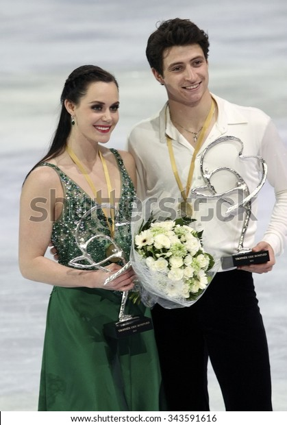 PARIS, FRANCE - NOVEMBER 16, 2013: Tessa VIRTUE / Scott MOIR of Canada pose during the victory ceremony in ice dance at Trophee Bompard ISU Grand Prix at Palais Omnisports de Bercy.