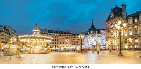 PARIS, FRANCE - NOVEMBER 17, 2016: Paris City Halll (Hotel de Ville) and the carousel at dusk. It was constructed in 1874 - 1882 by architects Theodore Ballou and Edouard Deperta.