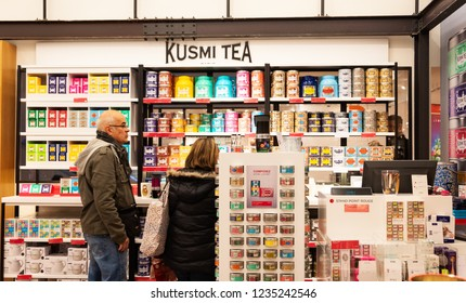 PARIS, FRANCE - NOVEMBER 17, 2018:  Man and woman choosing Kusmi tea at  BHV Marais department store. Founded in 1867 nowadays Kusmi offers classic green and black teas and exclusive gourmet  blends.