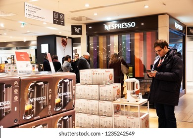 PARIS, FRANCE - NOVEMBER 17, 2018:  People shopping kitchen electric appliances and buy Nespresso coffee capsules at vending machine in BHV Marais department store.