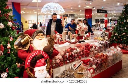 PARIS, FRANCE - NOVEMBER 17, 2018:  People choosing Christmas festive decor for winter holidays home decoration at BHV Marais department store.