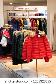 PARIS, FRANCE - NOVEMBER 17, 2018: Tommy Hilfiger store in BHV Marais department store. Tommy Hilfiger is a premium American clothing company, manufacturing clothes, footwear, accessories and perfume.
