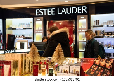 PARIS, FRANCE - NOVEMBER 17, 2018:  Women shopping at Estee Lauder counter in BHV Marais department store. Estee Lauder company world known for its makeup, fragrance, skin and hair care products.