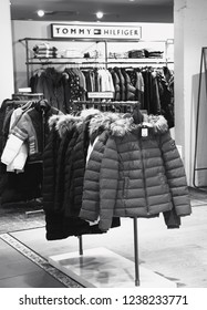 PARIS, FRANCE - NOVEMBER 17, 2018: Tommy Hilfiger store in BHV Marais department store. Tommy Hilfiger is a premium American clothing company. Black and white photo.