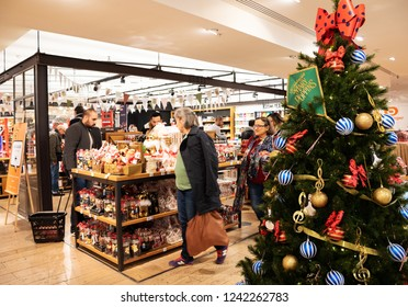 PARIS, FRANCE - NOVEMBER 17, 2018: People choosing delicious sweets, chocolates and teas at gourmet  grocery of BHV Marais department store decorated for Christmas.