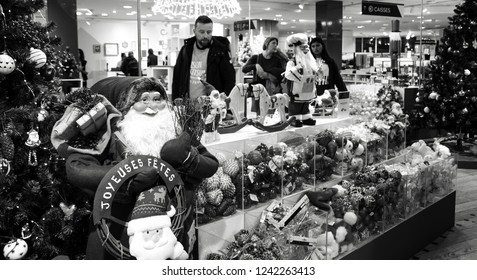PARIS, FRANCE - NOVEMBER 17, 2018:  People choosing Christmas festive decor for winter holidays home decoration at BHV Marais department store. Black and white photo.