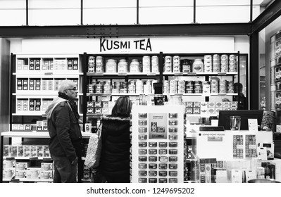 PARIS, FRANCE - NOVEMBER 17, 2018:  People choose Kusmi tea at  BHV Marais department store. Founded in 1867 Kusmi offers classic green and black teas and gourmet  blends. Black white. Selective focus