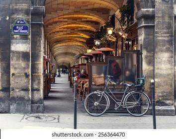 Paris, France - november 18, 2014: urban street view in Paris. Bistro cafe parisian