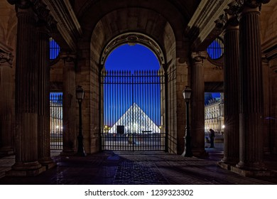 Paris, France - November 18, 2018: View of Louvre Pyramid from Cour Carree