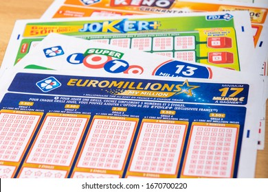 Paris, France -  November 20, 2019 : Closeup of french grids of lotto , Euromillions, Keno, Joker+  from the society FDJ  (La francaise des jeux)