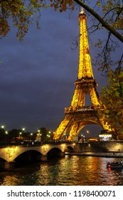 Paris, France - November 2017:  Eiffel tower illuminated at dusk. The Eiffel tower is one of the most recognizable landmarks in the world. Paris, France