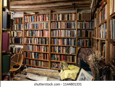 Paris, France - November 2017: Rows of old books on a bookshelf. Shakespeare & Company, Paris, France.