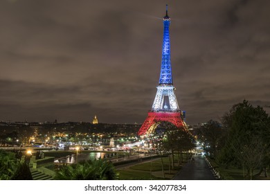 PARIS, FRANCE - NOVEMBER 21, 2015 :  The Eiffel Tower in national colors of France to prove that Paris is still standing after the terrorist attack of November 13, 2015.