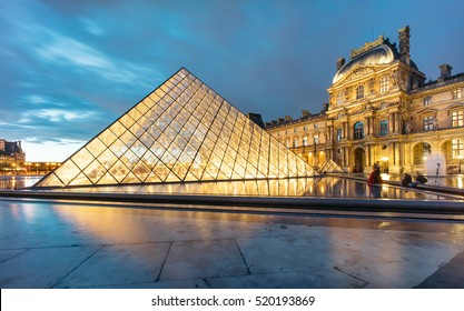 PARIS, FRANCE - NOVEMBER 21, 2016 : Louvre museum and its glass pyramid at night. Louvre museum is one of the world's largest museums with more than 8 million visitors each year.