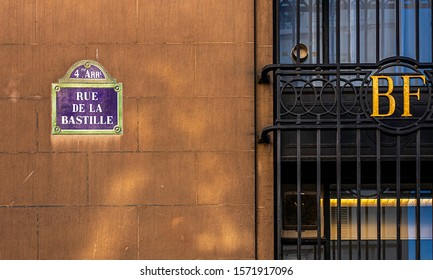 PARIS, FRANCE - NOVEMBER 21, 2019. Bastille district. on the wall of a building, a street sign indicates that we are on the place de la Bastille, in the 4th Arrondissement of Paris.