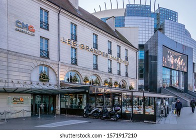 PARIS, FRANCE - NOVEMBER 21, 2019. Bastille district. Facade of a large restaurant decorated for Christmas and New Year's Day, and on the right, the Opera Bastille.