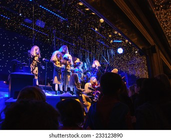 PARIS, FRANCE - NOVEMBER 23, 2014: Colorful Christmas decoration (depicting musical band performance)  in the windows of Printemps department store attracts Parisian children and tourists.
